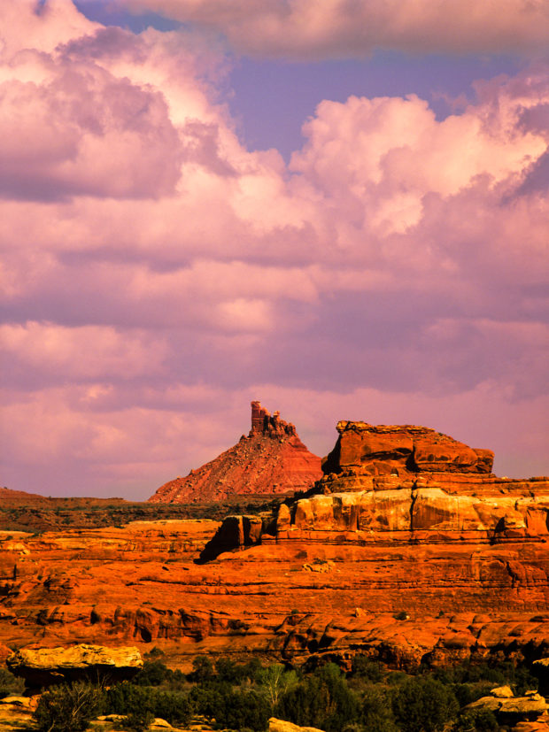 Standing high above the Utah desert, eye-catching Sixshooter Peak is the calling card