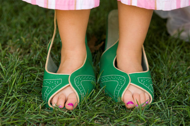 """Child's feet in adult shoes."" Initial Keywords: feet, shoes, girl, youth, grass, humor, outside. After using Keyword Catalog: child, juvenile, 4-12 years old, people, human beings, humans, person, body, foot, feet, fashion, clothing, apparel, clothes, womens clothing, womens apparel, women's clothing, attire, shoes, shoe, dress shoes, female, girl, lass, plants, grass, humor, outside, outdoors. ©David Riecks"