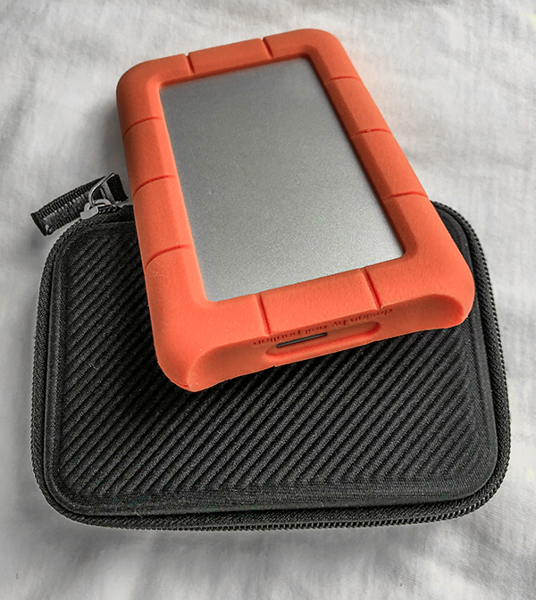 "LaCie Rugged drives feature a distinctive protective rubber bumper. Several other brands offer these tiny units with capacities up to at least 5 Terabytes. Their small 2.5"" diameter disks may have less longevity than their larger cousins."
