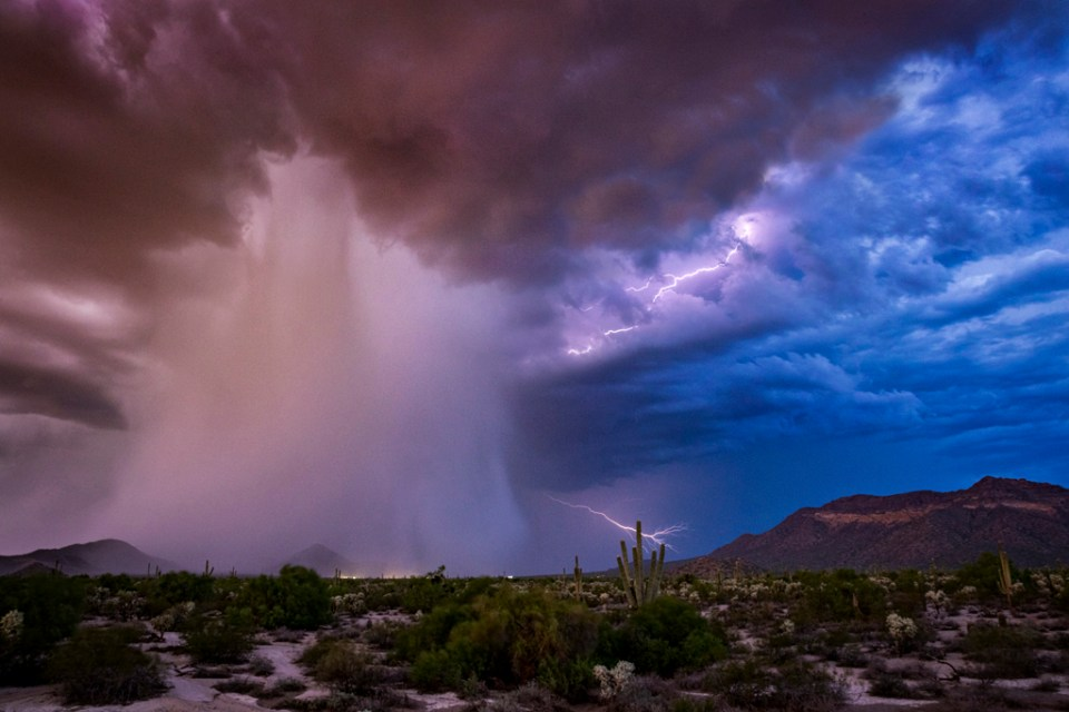 "Showcase 2019 Top 100 winner: ""A Thunderstorm Cell Pouring Rain on the Desert, Phoenix, Arizona"" © Scott Dere."