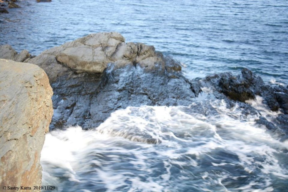 Photo of waves hitting a rock. 1/10 sec. f/5 40mm ISO 100 NIKON D7100 I was so intent on experimenting with the shutter speed that I didn't notice that the camera had locked focus on the foreground rock!