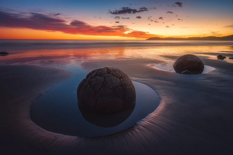 "Showcase 2020 Top 100 winner: ""Spherical Moeraki Boulders Are Otherworldly in the Early Light, Koekohe Beach, New Zealand South Island"" © Ian Frazier."