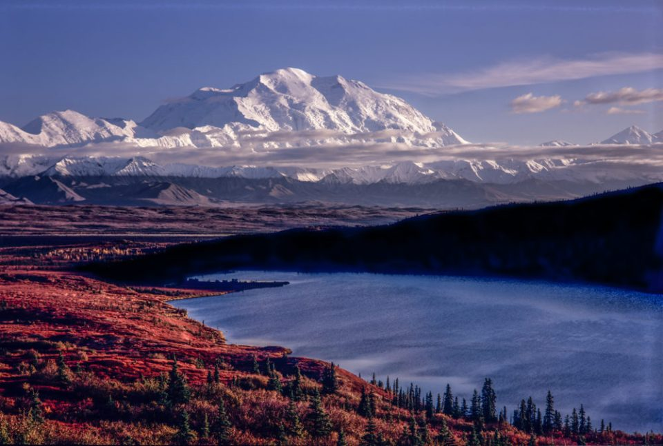 Massive Denali, at 20,340 feet high the tallest mountain in all of North America towers above Wonder Lake in Denali National Park.