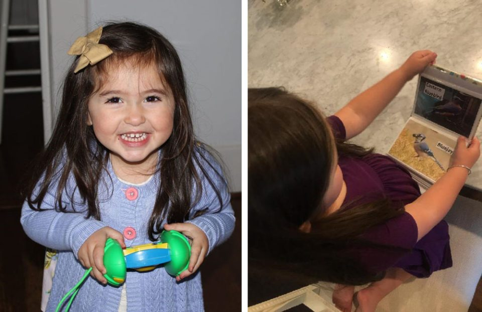 The author's granddaughter holds a Discovery Digital Camera (left) and his bird book (right).