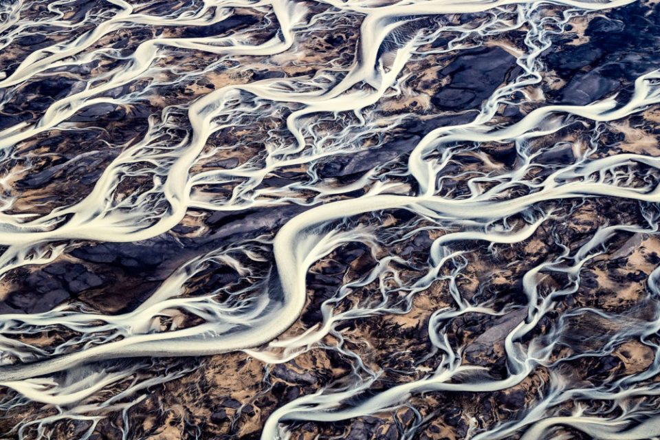 "Showcase 2020 Judges' Choice, Scapes: ""Over Iceland: Aerial View of Glacial Melt Waters"" © Greg Duncan."