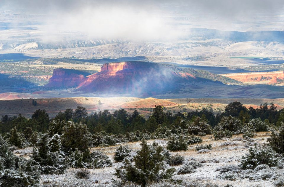 Landscape photo with mountains and snow.  Caption is The group explored the beauty of TNC Wyoming's Tensleep Preserve during an extended weekend visit.