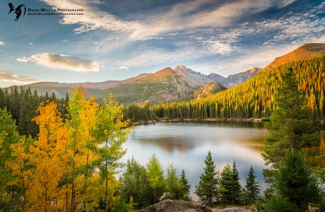 Photo of a lake before a tall mountain framed by golden aspen trees. Although the wildfires have created too much smoke in the air lately for good landscape photography, I am hoping that the cooler temps and changing weather patterns will help the firefighters put out the the fires in Colorado. This shot of the fall colors in Rocky Mountain National Park is a reminder of the beauty that is coming in the next few weeks.