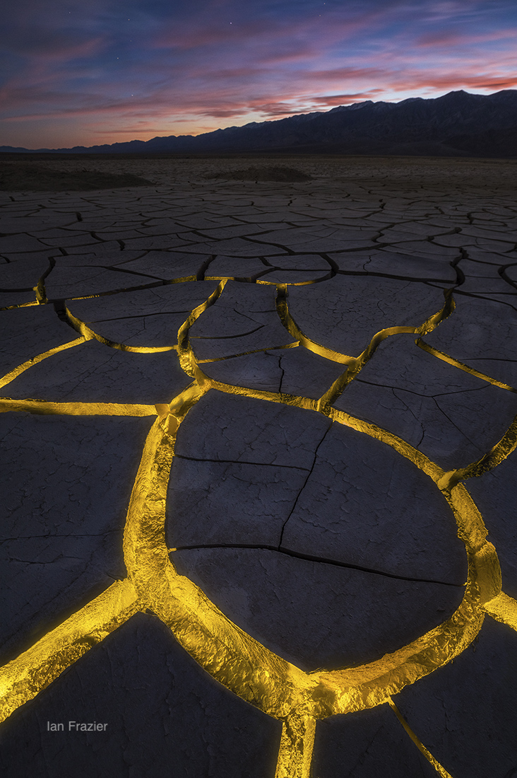 Went to Death Valley and found some amazing patterns in this dried mud flat. Used a small flashlight and multiple exposures to create something different as night fell. Death Valley National Park, California © Ian Frazier