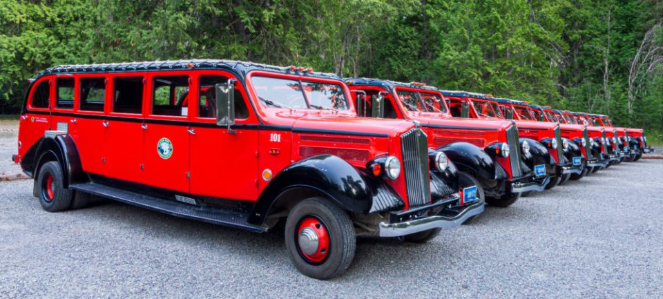 Parked Red Jammers at Glacier National Park, Montana © Frank Gallagher