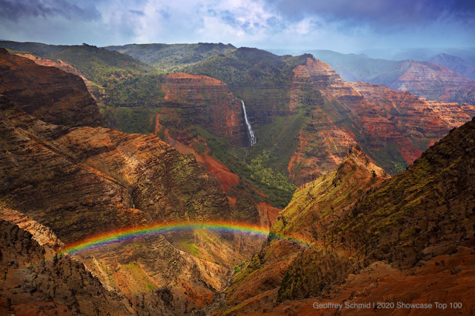 "Showcase 2020 Top 100 Winner: ""Rainbow Over the Grand Canyon of the Pacific, Waipio Falls in the Distance, Waimea Canyon, Kauai, Hawaii"" © Geoffrey Schmid"