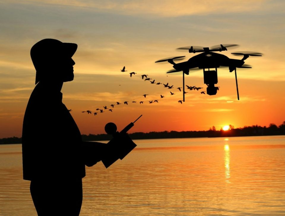 Photo of a man flying a drone. Drone Man Playing by Mohamed Hassan. Pixabay license.