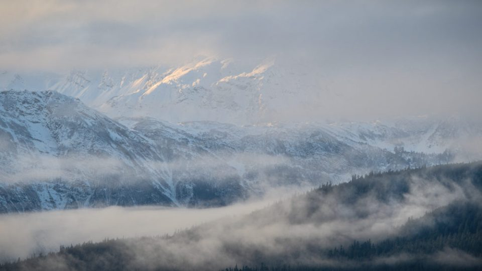 Sun Shining Through the Clouds on the Mountains of the Inside Passage. © Debbie McCulliss