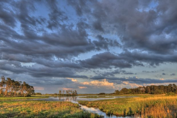 Sunset at Black Duck Pool, located on the east side of Beach Road at Chincoteague National Wildlife Refuge, Virginia. © Jim Clark