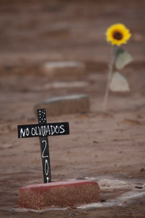 A pauper's cemetery in southern California houses many graves of unidentified migrants lost in the desert.