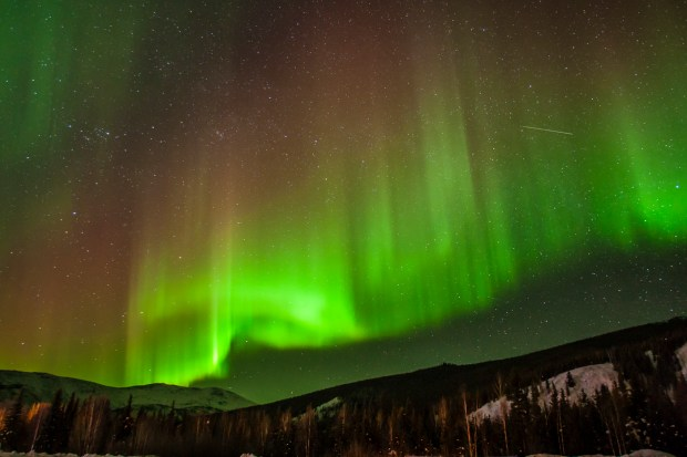North America, USA, Alaska, Chena Hot Springs, aurora borealis and stars. © Cathy & Gordon Illg