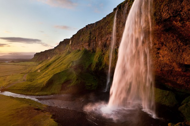 Iceland waterfall: Canon 5D mark II, 24-70 mm lens at 24 mm, f/16, Shutter speed 1/10, ISO 100. I used a polarizing filter. More detail in the water with a faster shutter speed. © Jennifer Wu
