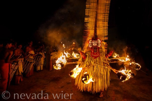 © Nevada Wier 2014. Kerala, India: Fire dancer, Theyyam Festival. Canon 5DMarkIII, Canon 16-35mm f/2.8, 1/125sec at f/3.5, ISO 1600 Shutter Priority. Evaluative Metering. Daylight White Balance. Flash not fired.