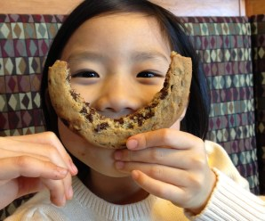 Ninjette smiling with a cookie smile.