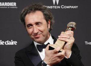 "Italian producer Nicola Giuliano holds up his award for Best Foreign Language Film for ""The Great Beauty"" at The Weinstein Company & Netflix after party after the 71st annual Golden Globe Awards in Beverly Hills"