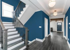 Stairwell with Blue walls and white accent