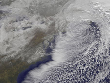 GOES-13 visible image of the powerful low pressure system that brought snows from Georgia to Maine on December 27