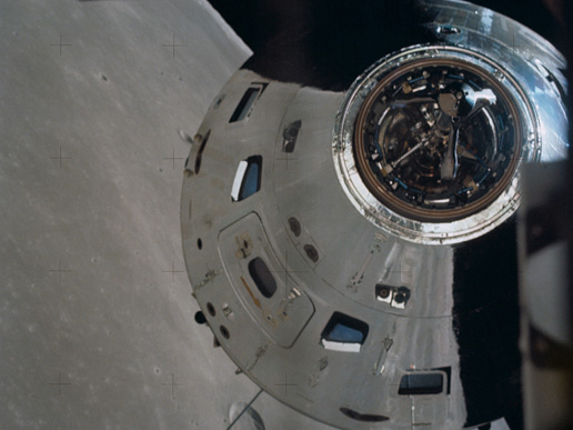 Surface of the moon reflected in Apollo 17's command and service module.