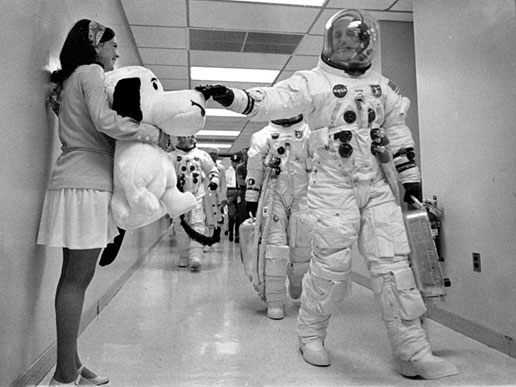 Apollo 10 commander Thomas P. Stafford pats the nose of Snoopy, the mission's mascot, held by Jamye Flowers, astronaut Gordon Coopers' secretary.