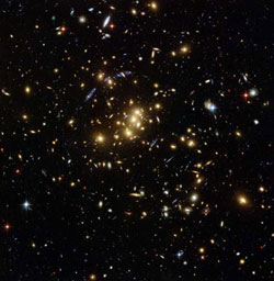 Image of the rich galaxy cluster, catalogued as Cl 0024+17, allowing astronomers to probe the distribution of dark matter in space.