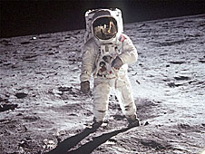 Aldrin wears a white spacesuit on the moon