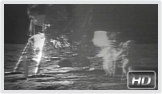 Aldrin and Armstrong raise the American flag on the moon.