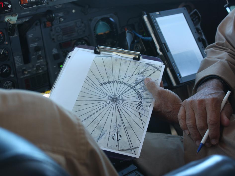 The DC-8 pilots on NASA's IceBridge mission point out the narrow Antarctic time zones on the navigation map.