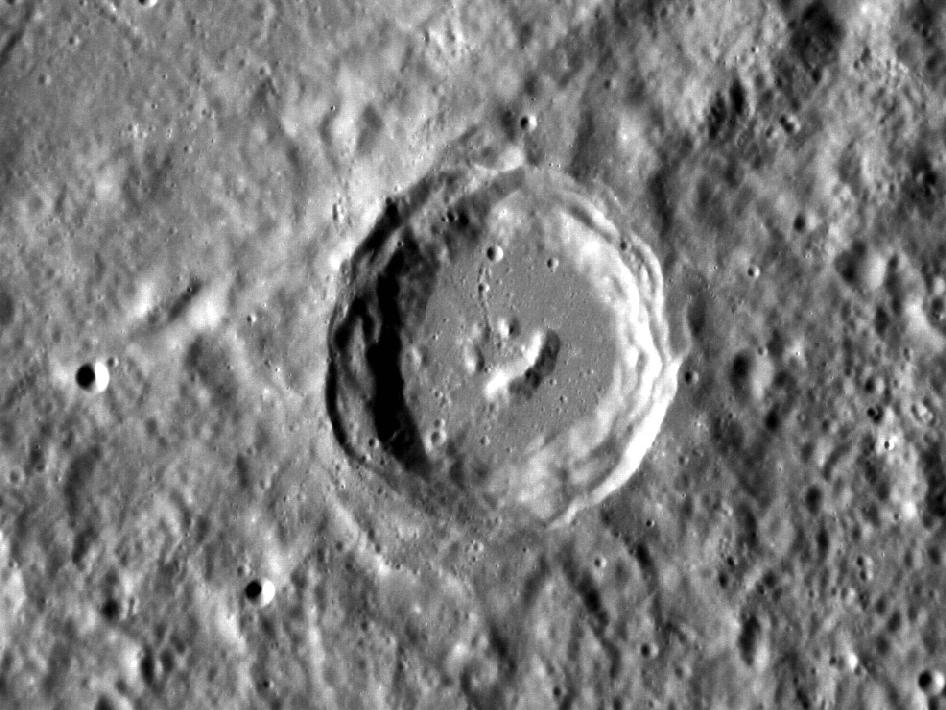 It looks like even the craters on Mercury have heard of Bob Ross! The central peaks of this complex crater have formed in such a way that it resembles a smiling face. This image taken by the MESSENGER spacecraft is oriented so north is toward the bottom.