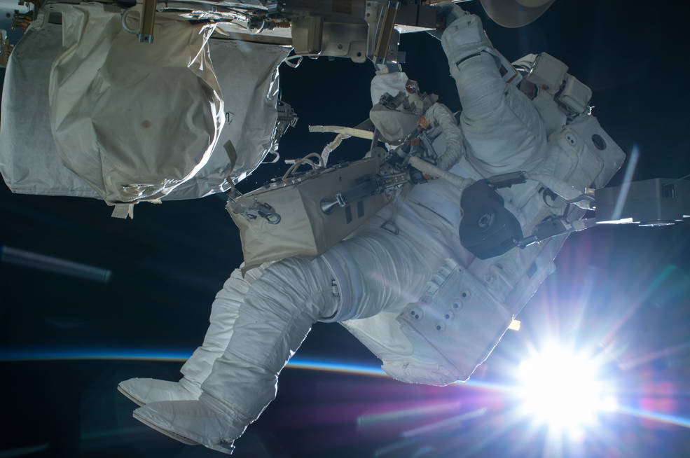 Astronaut Terry Virts conducts a spacewalk during an orbital sunrise on Feb. 21, 2015.