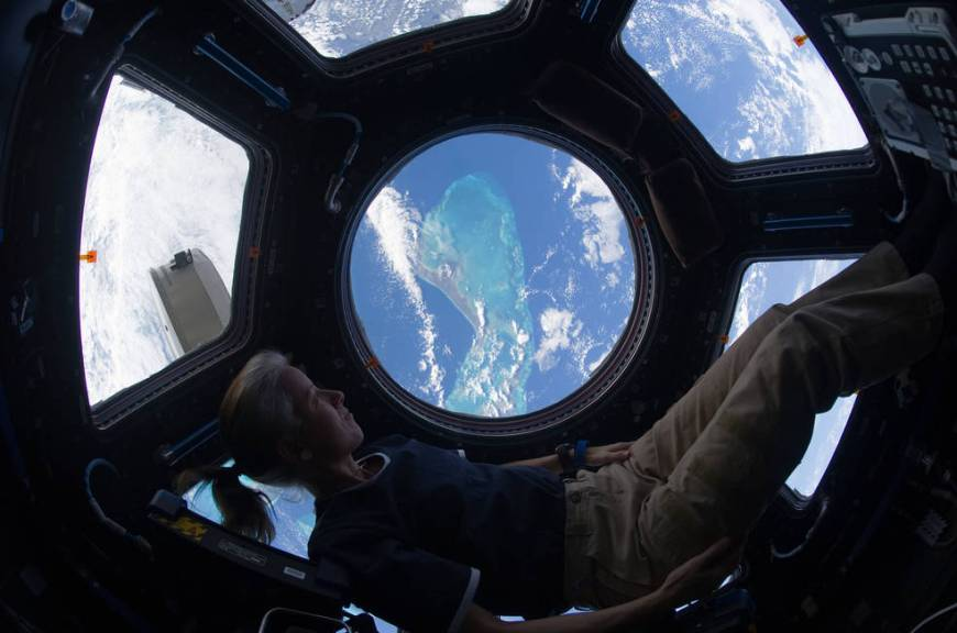 Shannon Walker looking out of the international space station's cupola at the Caribbean view beneath on November 25, 2010.