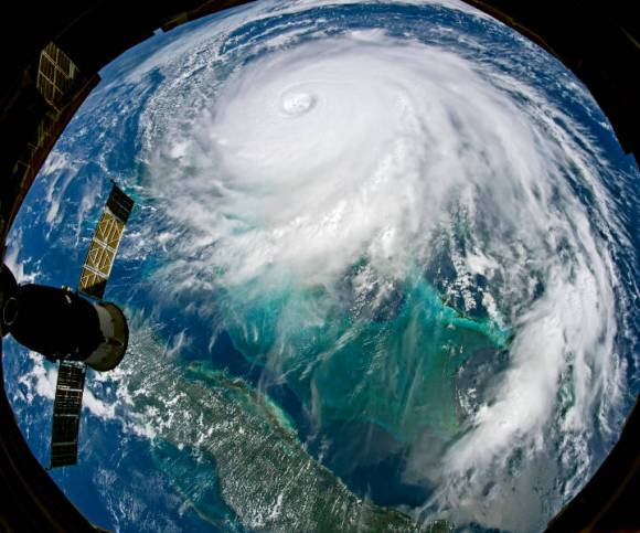 View from the International Space Station showing the white spiral clouds of Hurricane Dorian dominating the ocean.