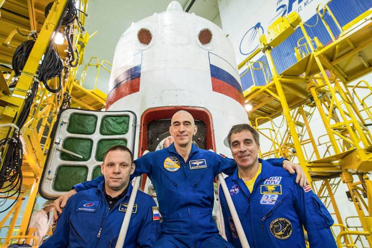 Expedition 63 crew members Ivan Vagner (left) and Anatoly Ivanishin (center) of Roscosmos and NASA astronaut Chris Cassidy