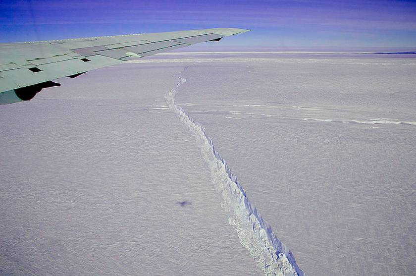 A photo from the window of NASA's DC-8 shows the rift across the Pine Island Glacier ice shelf running off toward the horizon. T