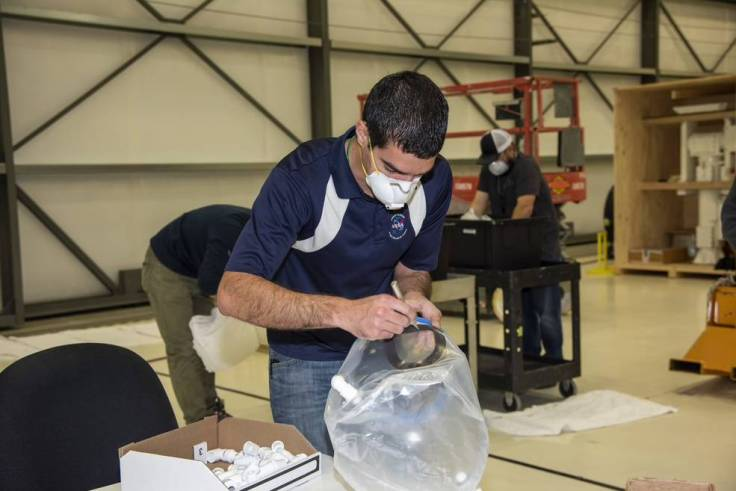 An employee works on the Aerospace Valley Positive Pressure Helmet,