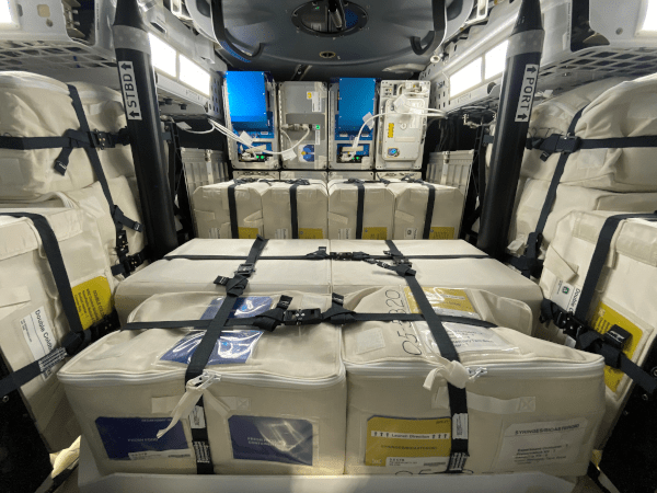 inside the Dragon spacecraft, filled with cargo