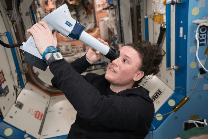 astronaut Serena Auñón-Chancellor conducts an eye exam aboard the space station