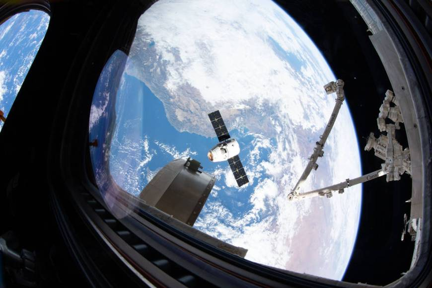 SpaceX's Dragon resupply ship slowly approaches the orbiting lab