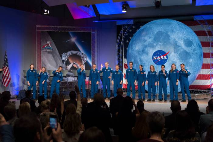 NASA's new class of astronauts appear on stage during their graduation ceremony at the agency's Johnson Space Center in Houston