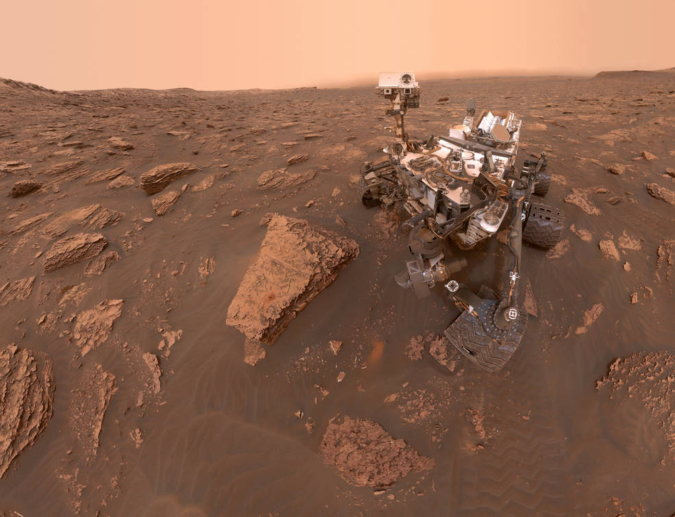 image of rover on Mars with rocks