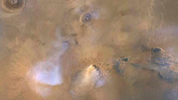 """The yellow-white cloud in the bottom-center of this image is a Mars """"dust tower"""""""