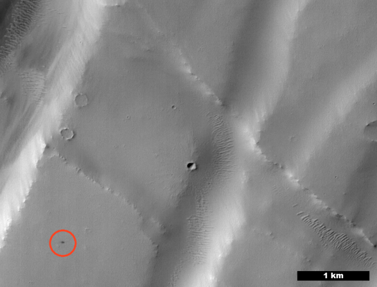 The black speck circled in the lower left corner of this image is a cluster of recently formed craters spotted on Mars