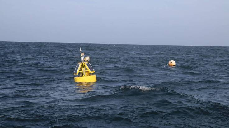 A buoy marks the West End CP mooring site south of Dauphin Island, Alabama