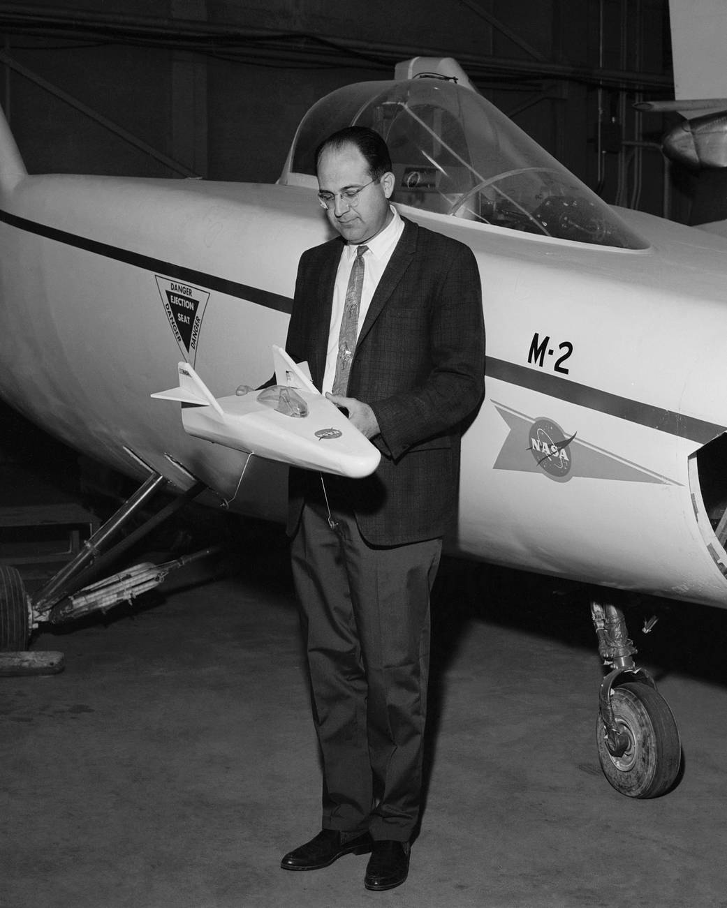 Dale Reed with a Model of the M2-F1 and the Actual M2-F1 Lifting Body
