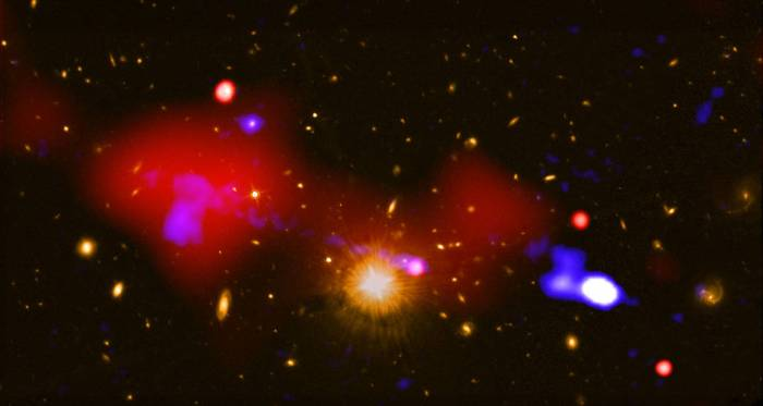 An image that contains a black hole that is triggering star formation across the longest distance ever seen.
