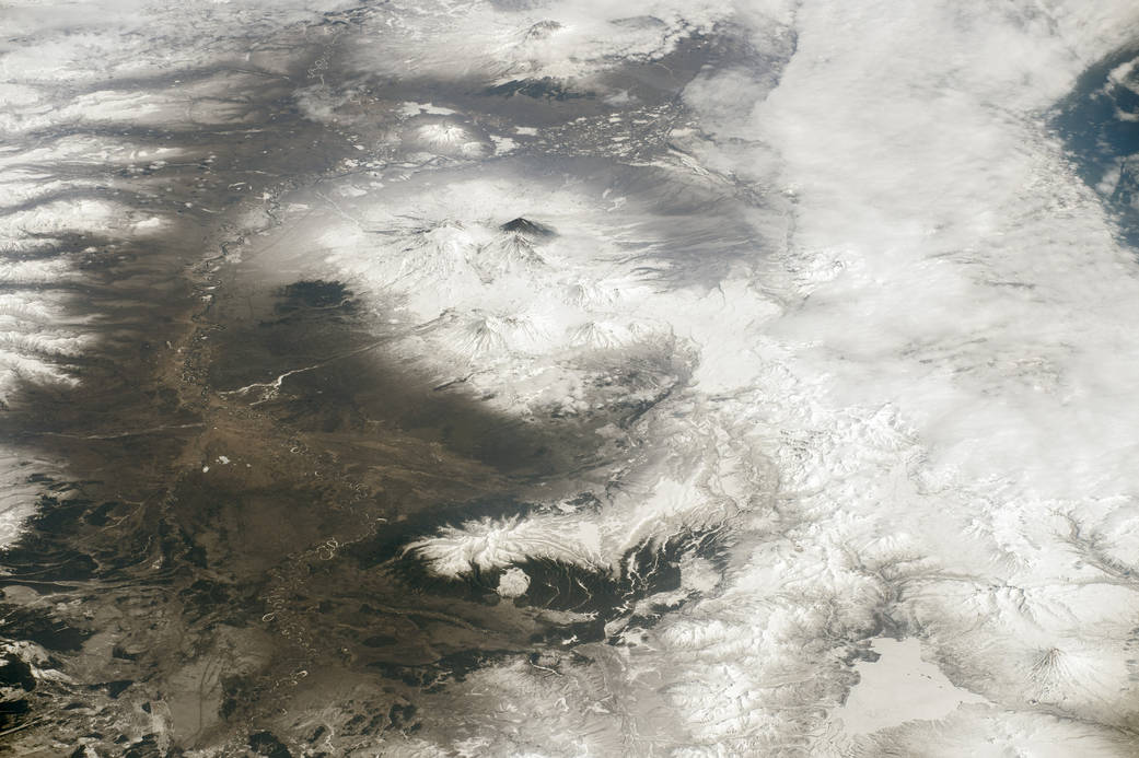 Image taken from space of mountain range with active volcanoes