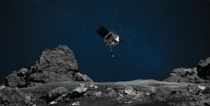 spacecraft above rocky asteroid terrain